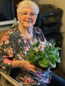 Mom with one of her violets